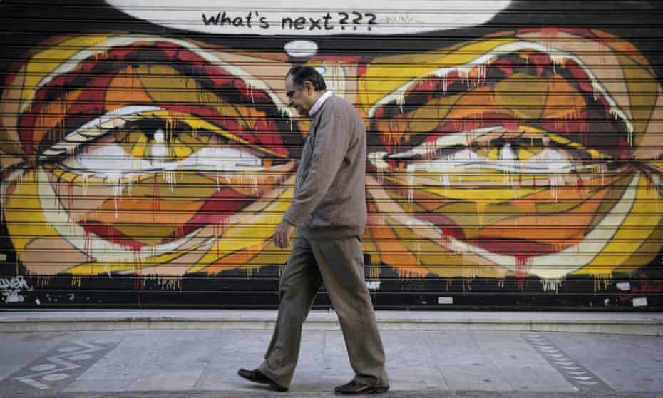 A man walks past graffitti with a thought bubble asking 'what's next?'