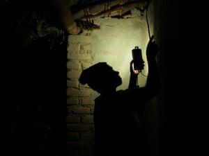 Edina Livitiko switches on her solar powered light in Kalolo, Malawi