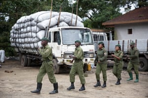 Rangers on parade. Behind them is a truck loaded with illegal charcoal that was confiscated.