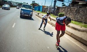 Lenny Alvin drafts behind Allan Ayigah on Nairobi's Thika superhighway.