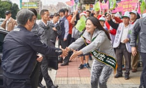 Lai Pin-yu greets people on the street ahead of the Taiwan election.