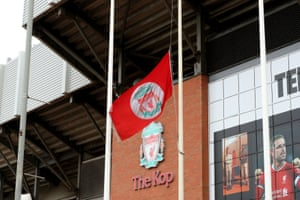 The Liverpool flag flies at half-mast outside the Kop.