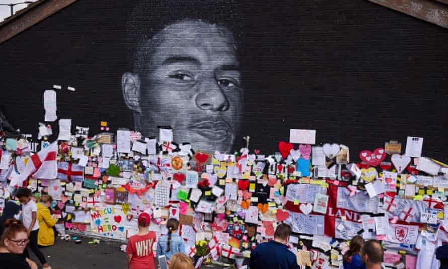 Crowds left messages at a mural of Manchester United and England footballer Marcus Rashford in Withington, south Manchester.