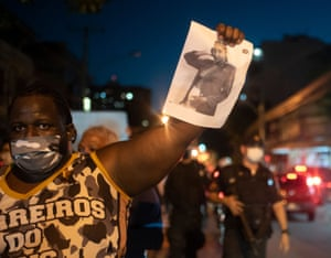 A demonstrator holds a photo of Kathlen Romeu at a protest in Rio de Janeiro, Brazil