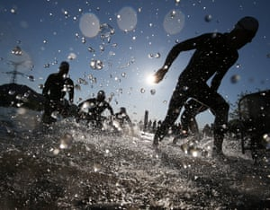 Athletes exit the swimming section of Ironman 70.3 Pays d'Aix, in Aix-en-Provence, France