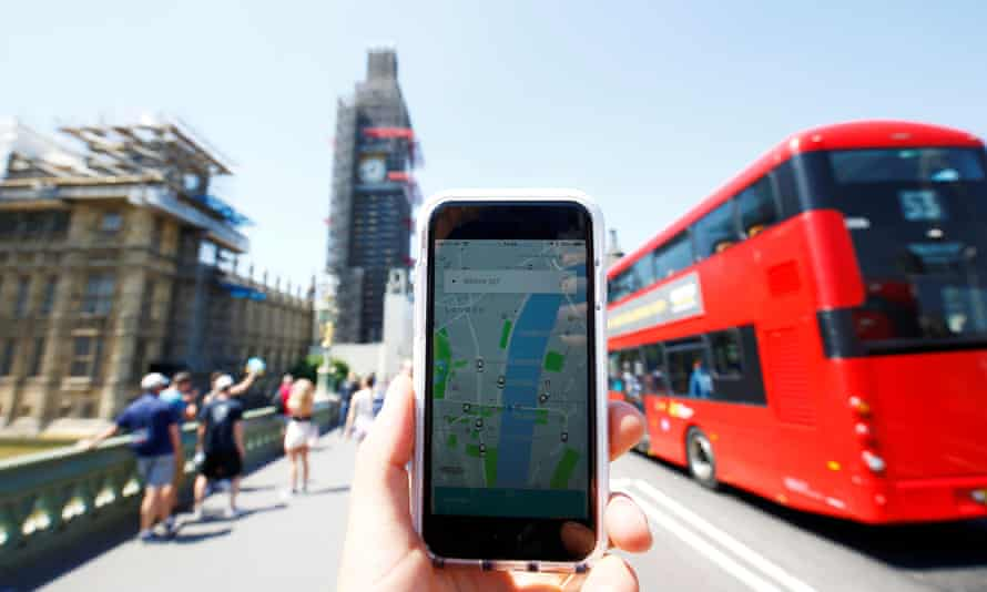 Uber app and a bus in London