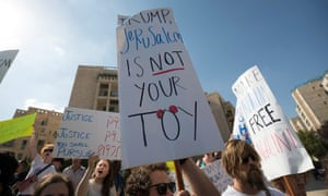 Israeli activists and Palestinians hold banners during a protest outside of the US embassy in Jerusalem, during the official inauguration ceremony