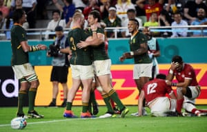 South Africa's Frans Steyn is congratulated by his teammates after scoring a try.
