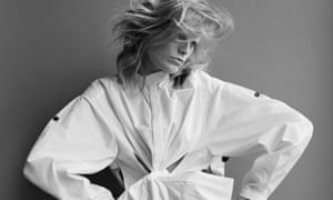 Hanne Gaby Odiele in an oversized puffy white shirt and with windswept hair