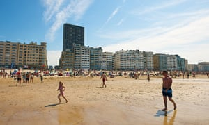 People enjoying the beach in Ostend, a coastal city, the largest on the Belgian coast