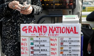 A bookie counts money at the 2019 Grand National at Aintree.