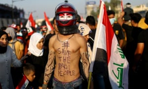 Iraqi demonstrators take part at the ongoing anti-government protests in Baghdad, Iraq, on 1 November.