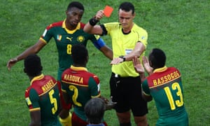 Cameroon's Emest Mabouka is shown a red card by referee Wilmar Roldan after advice from the VAR during the Confederations Cup in Russia in 2017.