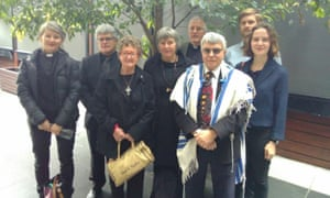 A rabbi, Uniting church reverend, former Catholic priest and Buddhist leader call for Josh Frydenberg to withdraw support for Carmichael mine.