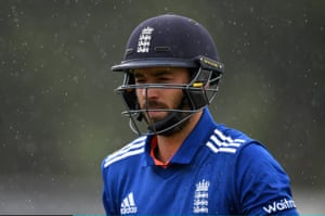 James Vince leaves the field as the rain falls.