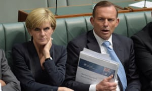 Julie Bishop and Tony Abbott on the frontbench during his time as prime minister. Bishop has said Abbott needs to explain his change of heart on global warming.