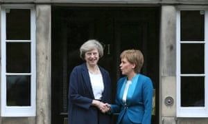 Scotland's First Minister Nicola Sturgeon greets Britain's new Prime Minister Theresa May as she arrives at Bute House in Edinburgh