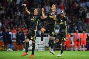 Mario Mandzukic, Cristiano Ronaldo and Douglas Costa celebrate their team's victory at Parma.