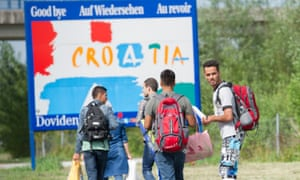 A group of Afghan refugees walk to the main Croatian border crossing with Slovenia, Obrezje-Bregana, west of Zagreb.