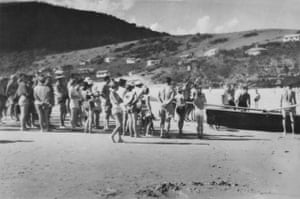 A surf boat and group on Era beach in the 1950s