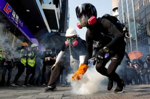An anti-government protester holds a teargas canister during a protest in Hong Kong.