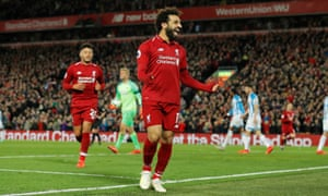 Liverpool's Mohamed Salah celebrates after scoring his side's fifth.