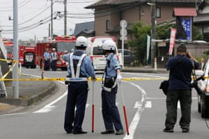 Japanese police outside Tsukui Yamayuri-en, a residential care facility for disabled people in Sagamihara,.
