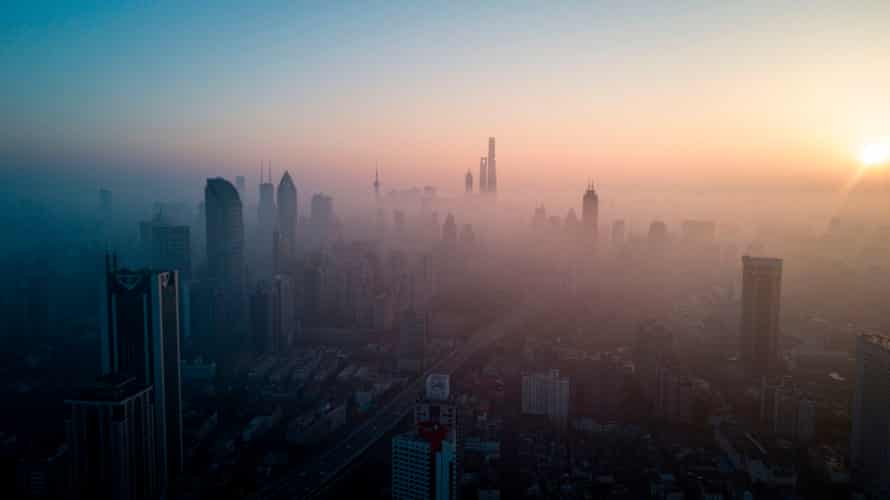 Bad air day … the sun rises in Shanghai on 23 February 2018.