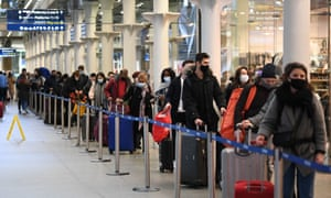 People queue at St Pancras International in London for the last train to Paris on Sunday.