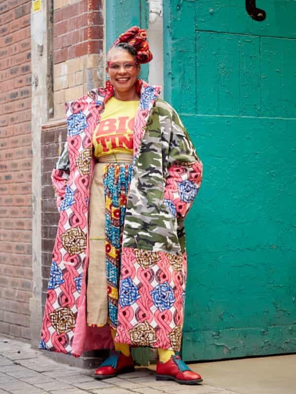 Designer and campaigner Karen Arthur, full length, in multi-coloured clothing