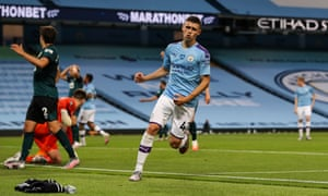 Phil Foden celebrates scoring his second and Manchester City's fifth.