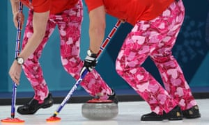 The Norwegian men's curling team sport Valentine's Day-themed trousers during their match against Japan.