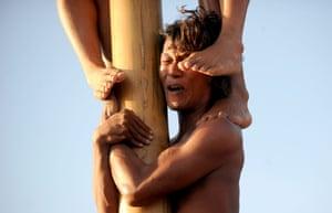 Seminyak beach, BaliParticipants climb greasy poles to claim a prize at Seminyak beach on the resort island of Bali