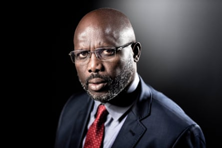 Former football player and candidate in Liberia's presidential elections, George Weah poses during a photo session in Paris during September 2017