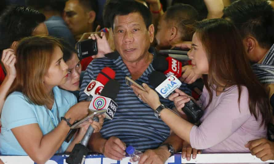 Rodrigo Duterte, the front-running presidential candidate, talks to the media during a campaign sortie at Silang township, Cavite province south of Manila, Philippines.
