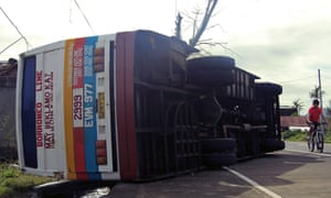 A bus toppled by strong wind from Typhoon Nock-ten in Albay province, Philippines.