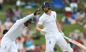 England's startled Chris Woakes was caught batting too defensively as a jubilant Quinton de Kock runs past.