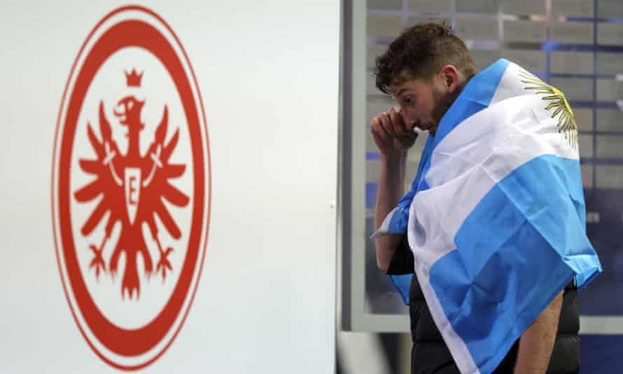 The Argentinian defender David Abraham appears to wipe away a tear as he leaves the pitch at Deutsche Bank Park for the final time.