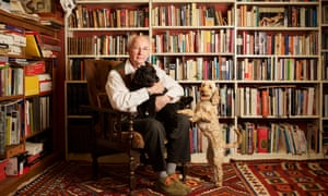 Philip Pullman photographed at home in Oxfordshire with his cockapoos, Coco and Mixie.
