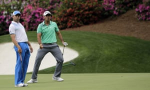 Sergio Garcia watches as Australia's Jason Day misses an eagle putt on the 13th