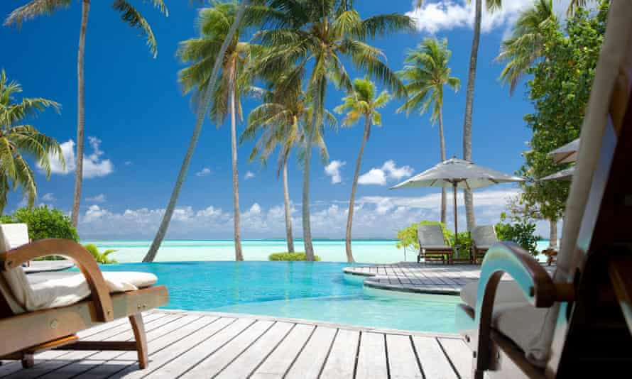 Infinity swimming pool at tropical luxury resort