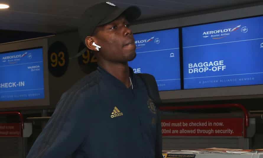 Paul Pogba checks in for Manchester United's flight to Valencia.