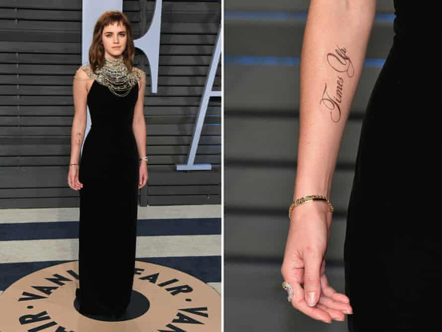 Branded … Emma Watson shows off her Time's Up tattoo at the Vanity Fair Oscars party