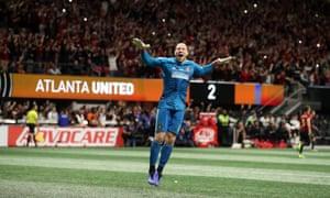 Brad Guzan celebrates as Atlanta's victory is confirmed