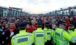 Some of the police and Cologne fans outside the Emirates.