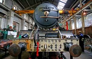 Flying Scotsman undergoing restoration work at Riley & Son locomotive works.