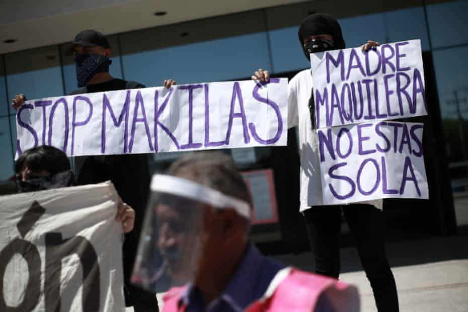 Protestors outside government offices demonstrate over hygiene in factories in Ciudad Juarez, 12 May.
