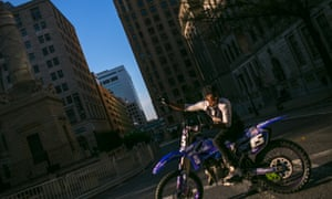A rider manages traffic on a Sunday in Baltimore. Different riders take turns holding traffic for the rest of the pack