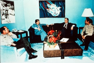 Noriega (right) in a meeting with George HW Bush in 1983