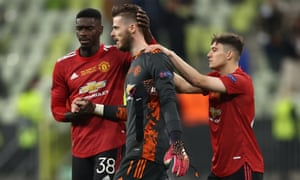 David De Gea is consoled by teammates Axel Tuanzebe and Daniel James following their defeat in the penalty shoot-out.